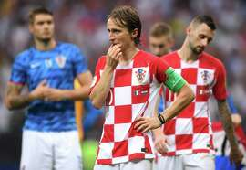 A dejected Luka Modric ponders what went wrong following the final whistle. Modric, though, was awarded the Golden Ball for best player of the Cup.