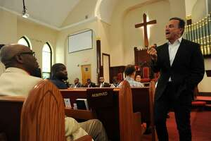 Bridgeport mayor and candidate for governor Joe Ganim delivers his opening statement to a forum for Democratic candidates at the Varick Memorial A.M.E. Zion Church in New Haven Sunday.