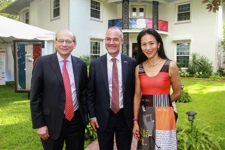 David Leebron, from left, Le Consul général de France, Monsieur Alexis Andres, and Y. Ping Sun at the Bastille Day cocktail reception celebrating the French Republic's National Day.