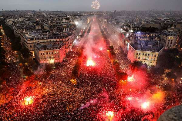 TOPSHOT - This picture taken from the top of the Arch of Triumph (Arc de Triomphe) on July 15, 2018 shows people lighting flares as they celebrate after France won the Russia 2018 World Cup final football match against Croatia, on the Champs-Elysees avenue in Paris.  / AFP PHOTO / Ludovic MARINLUDOVIC MARIN/AFP/Getty Images