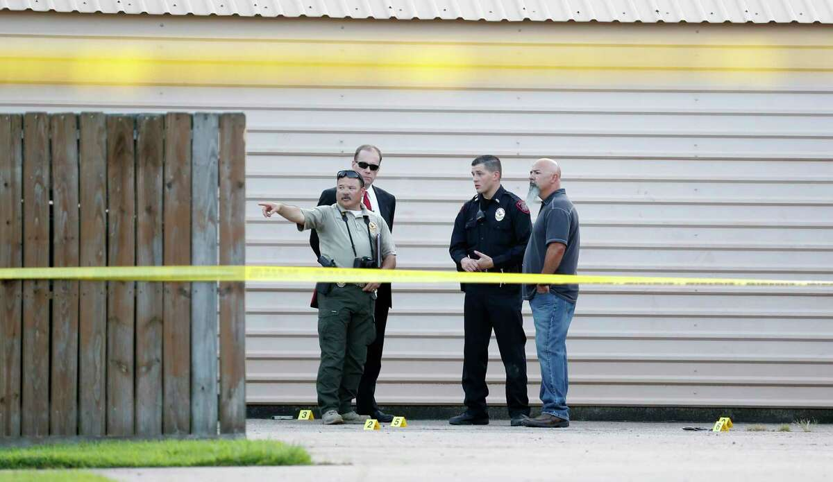 Alvin Police invesitgate the scene of a shooting at the Alvin Missionary Baptist Church on West Lang Street, Sunday, July 15, 2018, in Alvin.