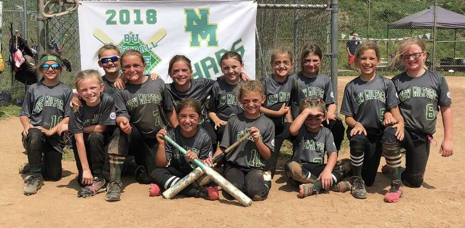 The New Milford Chaos 8-year-old softball team, including players (front row, from left) Carly Coloneri, Kaitlyn Bohrman and Emilee Shanks; and (back row) Tierney Atherton, Makayla Gillette, Megan Bohrman, Krista Manka, Mairead Bell, Katelyn Simmons, Brooklynn Romaniello, Haley Goodrich, Lydia Rocky and Lillian Fortier. The team is coached by head coach Ray Manka and assistants Jerry Romaniello, Bob Gillette, Drew Rocky and Pam Simmons. Photo: Contributed Photo / Contributed Photo