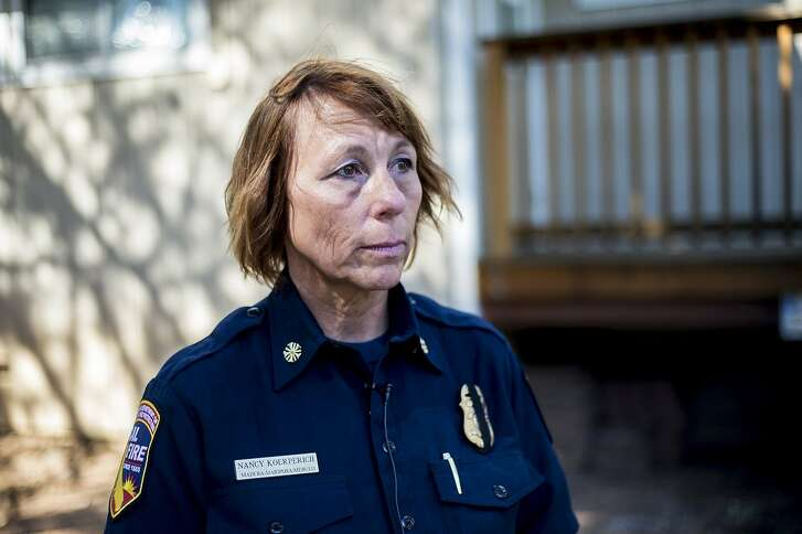 In this Saturday, July 14, 2018 photo, California Department of Forestry and Fire Protection Unit Chief Nancy Koerperich, speaks on the tragic death of firefighter and dozer operator Braden Varney, 36, who died Saturday while fighting a wildfire near Yosemite National Park, in Mariposa County, Calif. (Andrew Kuhn/The Merced Sun-Star via AP)