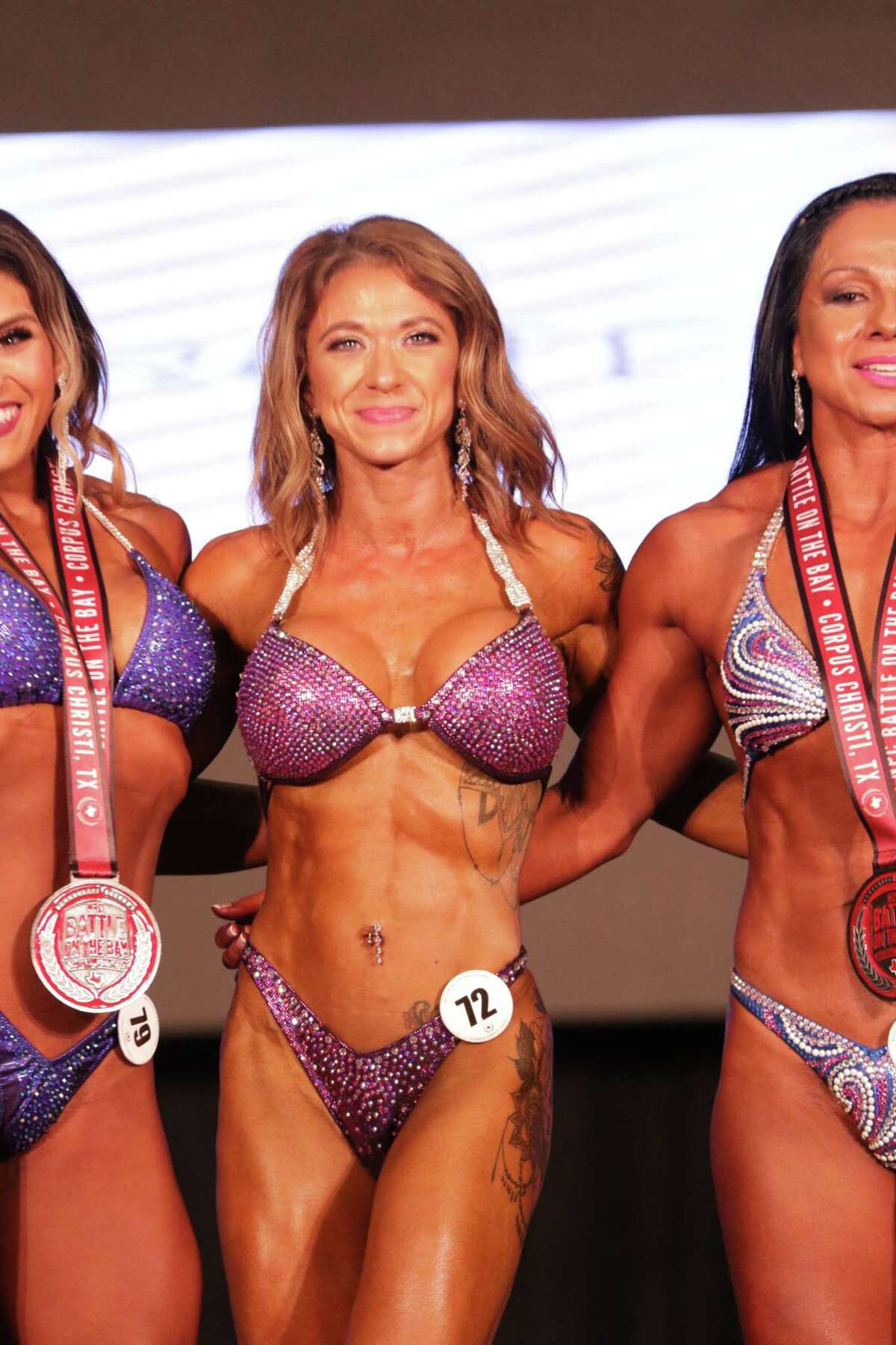 Ashley Tolson won gold cups inwomen?'s figure novice and open classic at the NPC Battle on the Bay.