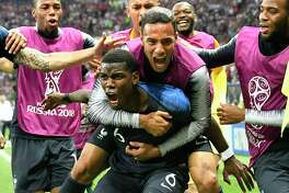 France's Paul Pogba celebrates after scoring his side's third goal during the final match between France and Croatia at the 2018 soccer World Cup in the Luzhniki Stadium in Moscow, Russia, Sunday, July 15, 2018. (AP Photo/Martin Meissner)