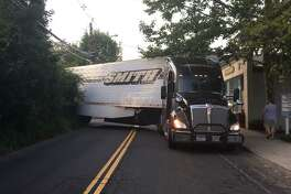 Saugatuck Avenue was closed for about two hours on Sunday, July 15, 2018 after it got stuck on a wall while attempting to make a right turn from Sunrise Road. The truck had to be unloaded before it could be moved.