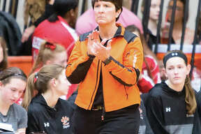 Edwardsville coach Lori Blade encourages her team during a Jan. 12 home win over Alton. The Tigers went on to win a ninth straight Southwestern Conference championship and Blade is the 2018 Telegraph Large-Schools Girls Basketball Coach of the Year.