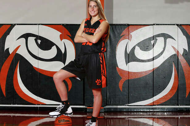 Edwardsville's Kate Martin is the 2018 Telegraph Large-Schools Girls Basketball Player of the Year. The AP Class 4A first team all-stater signed with Iowa helped the Tigers to a 122-6 with a pair of state trophies in her four seasons at EHS.
