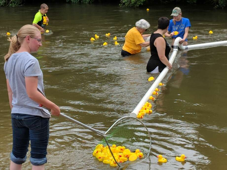 Rain predictions didn't keep many at bay for the Gladwin Arts and Crafts Festival in Gladwin City Park, held in conjunction with the Great Cedar River Duck Race. Hundreds attended the festival and Hospice of Gladwin Area sold out its ducks, an estimated 700. The event drew residents from Gladwin, Midland and other counties. (Tereasa Nims/for the Daily News) Photo: Tereasa Nims/for The Daily News