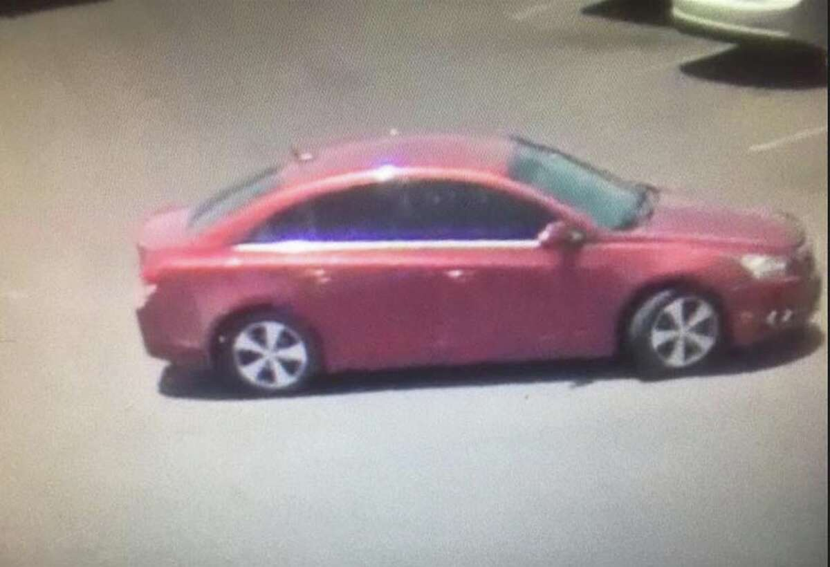 Laredo police said a man left in this red car after he allegedly took a purse from a shopping car at a local store.