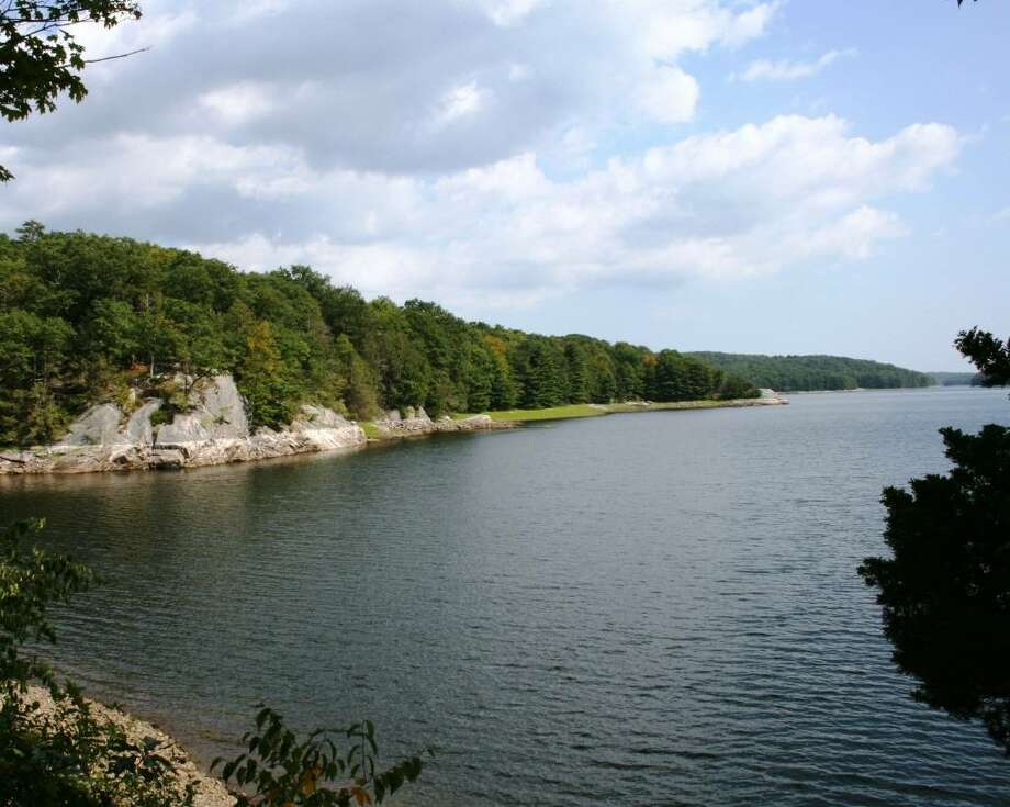 Aquarion Water Company has asked customers to limit their water usage in light of historically high demand. The Saugatuck Reservoir in Redding, pictured, provides water for the Westport area. Photo: Contributed Photo / Westport News