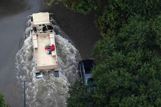 A rescue vehicle drives through a neighborhood off Cypress Creek as floodwaters rise from Tropical Storm Harvey on Tuesday, Aug. 29, 2017, in Houston. ( Brett Coomer / Houston Chronicle )
