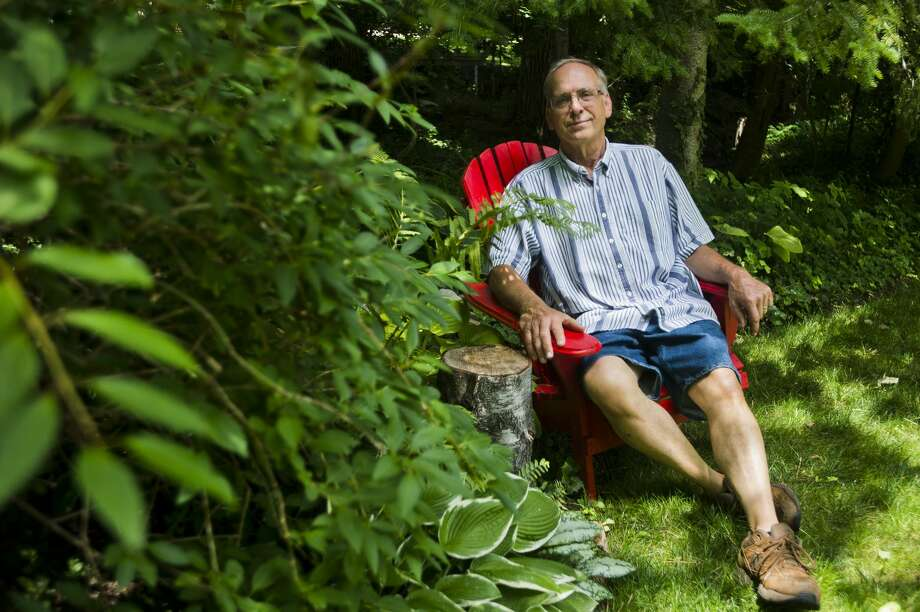 Terry Tanner poses for a portrait in his backyard garden on July 2, 2018. (Katy Kildee/kkildee@mdn.net) Photo: (Katy Kildee/kkildee@mdn.net)
