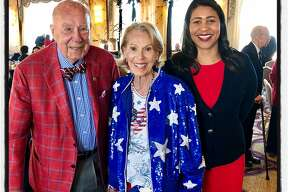 Former Secretary of State George Shultz and his wife Protocol Chief Charlotte Shultz (left) with Mayor London Breed. July 4, 2018.