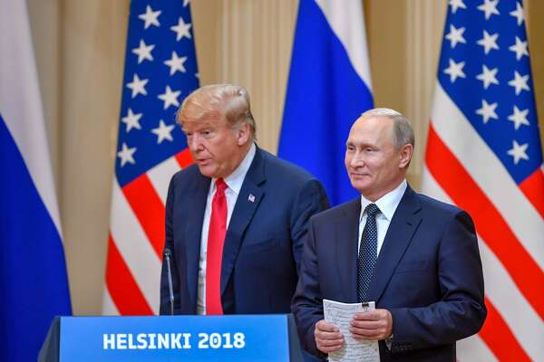 "US President Donald Trump (L) and Russia's President Vladimir Putin arrive to attend a joint press conference after a meeting at the Presidential Palace in Helsinki, on July 16, 2018. - The US and Russian leaders opened an historic summit in Helsinki, with Donald Trump promising an ""extraordinary relationship"" and Vladimir Putin saying it was high time to thrash out disputes around the world."