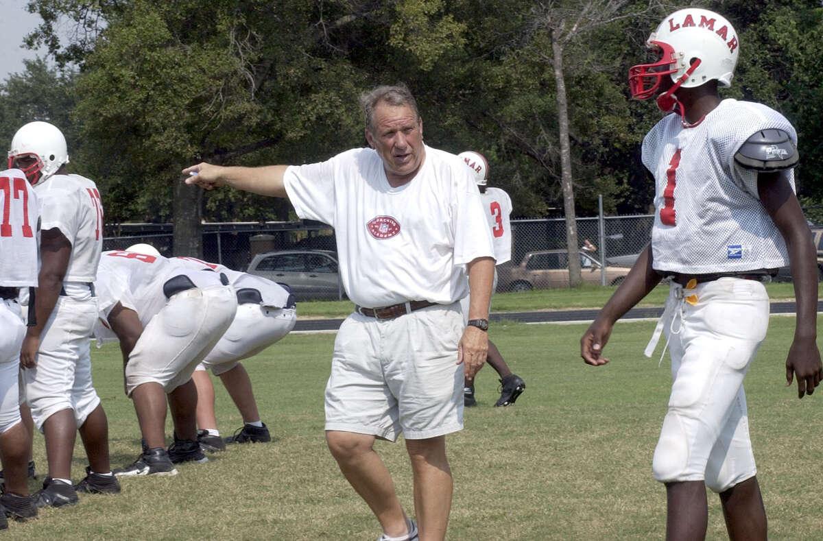Lamar High School Head Coach Tom Nolen talks with #1 Brandon LaFell during practice. (Photo by Kim Christensen)