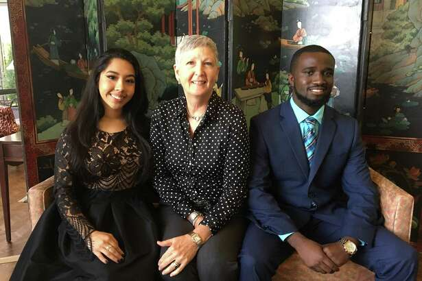Sheleigh Beggs, middle, Communities in Schools Project Manager at Lamar High School, with two of her students.