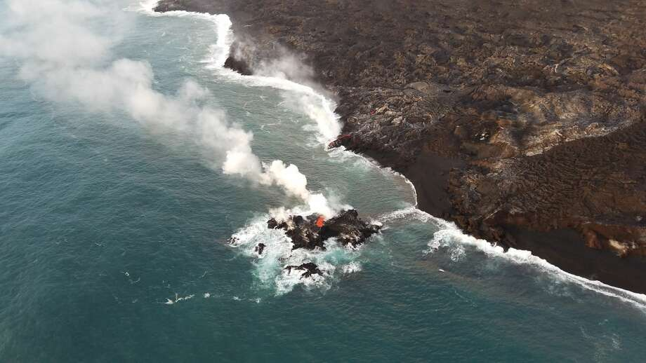 On a flyover of the eruption Kilauea volcano Friday, scientists with the United States Geological Survey noticed the new island of lava off the coast of Hawaii's Big Island. Photo: USGS