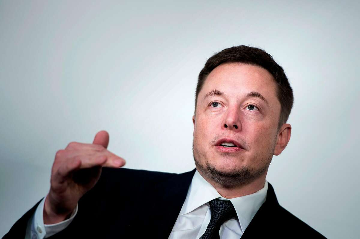 (FILES) In this file photo taken on July 19, 2017, Elon Musk, CEO of SpaceX and Tesla, speaks during the International Space Station Research and Development Conference at the Omni Shoreham Hotel in Washington, DC. American space entrepreneur Elon Musk tweeted that he was in Thailand on Tuesday July 8, 2018, with a prototype mini-sub, at the flooded cave where five members of a youth football team remained trapped. / AFP PHOTO / Brendan SmialowskiBRENDAN SMIALOWSKI/AFP/Getty Images
