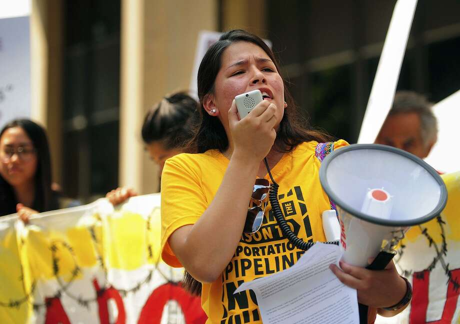 Vanesa Suarez, of New Haven, Conn., of the group Unidad Latina en Accion, leads an immigration rally outside the Federal Courthouse in Bridgeport, Conn. on Wednesday, July 11, 2018. Lawyers for two immigrant children detained in Connecticut after being separated from their parents at the U.S.-Mexico border asked a federal judge on Wednesday to order that the girl and boy be reunited with their families. It's expected that the parents will be reunited with the children on Monday, July 16, 2018. (Brian A. Pounds/Hearst Connecticut Media via AP) Photo: Brian A. Pounds / Associated Press / Connecticut Post