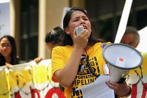 Vanesa Suarez, of New Haven, Conn., of the group Unidad Latina en Accion, leads an immigration rally outside the Federal Courthouse in Bridgeport, Conn. on Wednesday, July 11, 2018. Lawyers for two immigrant children detained in Connecticut after being separated from their parents at the U.S.-Mexico border asked a federal judge on Wednesday to order that the girl and boy be reunited with their families. It's expected that the parents will be reunited with the children on Monday, July 16, 2018. (Brian A. Pounds/Hearst Connecticut Media via AP)