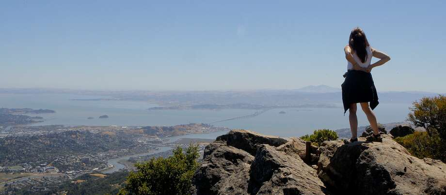 From an outcrop on Mount Tam's summit, Denese Stienstra takes in the view across to Mount Diablo. Photo: Tom Stienstra / The Chronicle