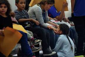 Recent immigrants and their children are dropped off at a McAllen bus station from detention. These families with children under 7 years old were not separated. Volunteers from Catholic Charities of the Rio Grande Valley with the help of the Sacred Heart Church led them to the respite center to provide assistance. Most came without shoelaces, some with ankle bracelets. They will be transported to various states.