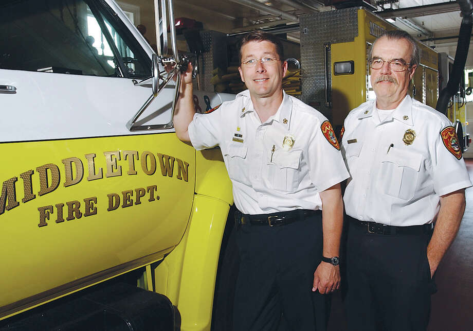 Middletown Fire Chief Robert Ross and Deputy Chief William Lawson are shown in the firehouse on Thursday.............TW photo.........061704 Photo: Middletown Press File Photo