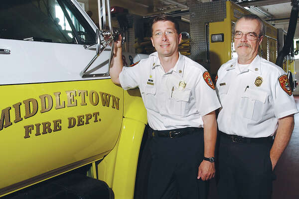 Middletown Fire Chief Robert Ross and Deputy Chief William Lawson are shown in the firehouse on Thursday.............TW photo.........061704