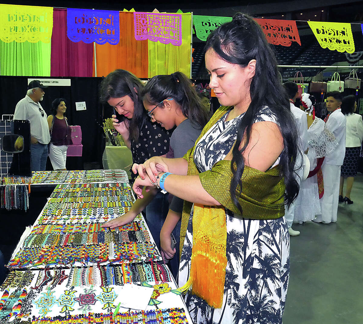 Miriam Davila shops for a bracelet at the 16th Annual Laredo International Sister Cities Festival, Friday, July 13, 2018 at the Sames Auto Arena. There will be arts and crafts, leather goods, jewelry, pottery, food, music, clothing and folkloric dances and presentations at the event free event through Sunday.