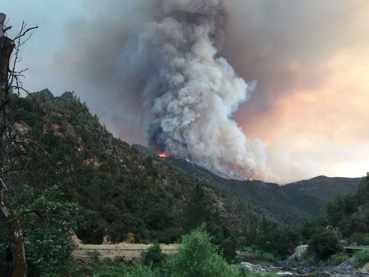 The Ferguson Fire, burning in steep, rugged terrain in Sierra National Forest on Sunday, July 16, 2018. It has closed Highway 140 and is threatening a number of structures.