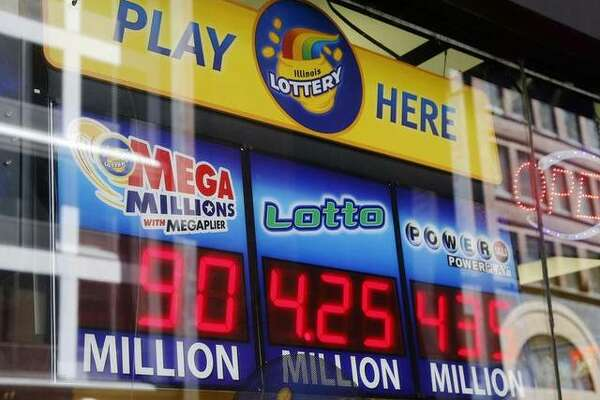 Signs display the lottery prizes, Thursday, June 8, 2017, in Chicago. The Powerball jackpot had grown up to $435 million, after more than two months without a winner. The jackpot for Saturday night's drawing would tie for the nation's 10th largest lottery prize. (AP Photo/G-Jun Yam)