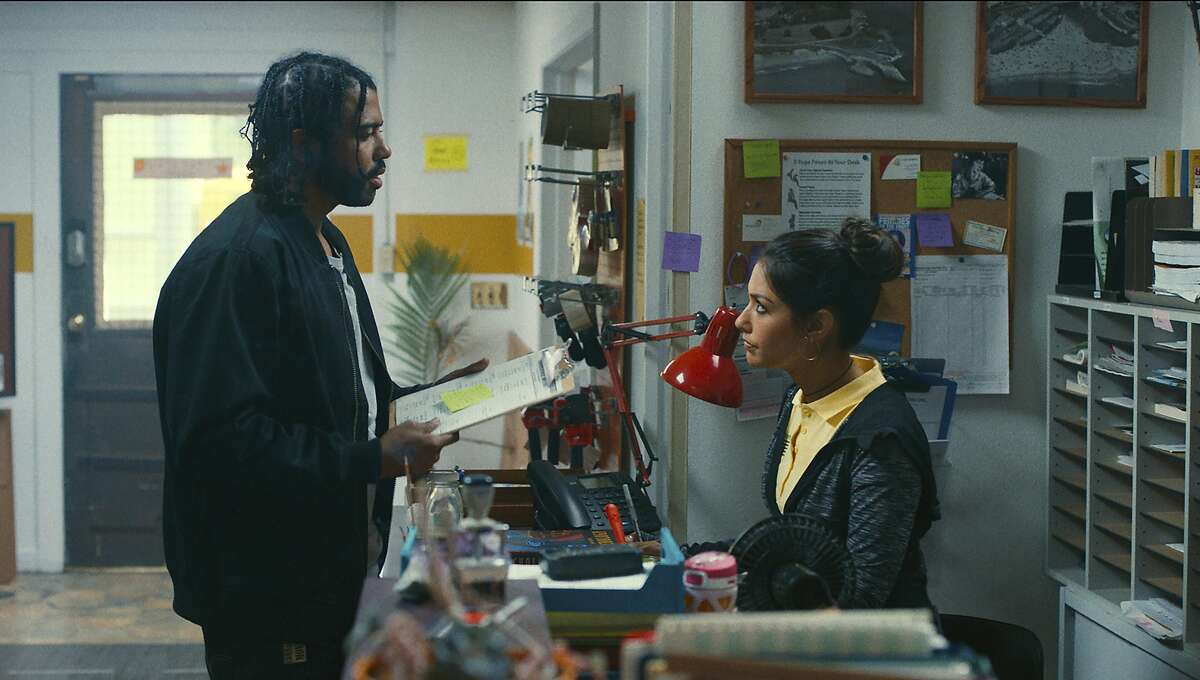"""This image released by Lionsgate shows Daveed Diggs, left, and Janina Gavankar in a scene from """"Blindspotting."""" (Lionsgate via AP)"""