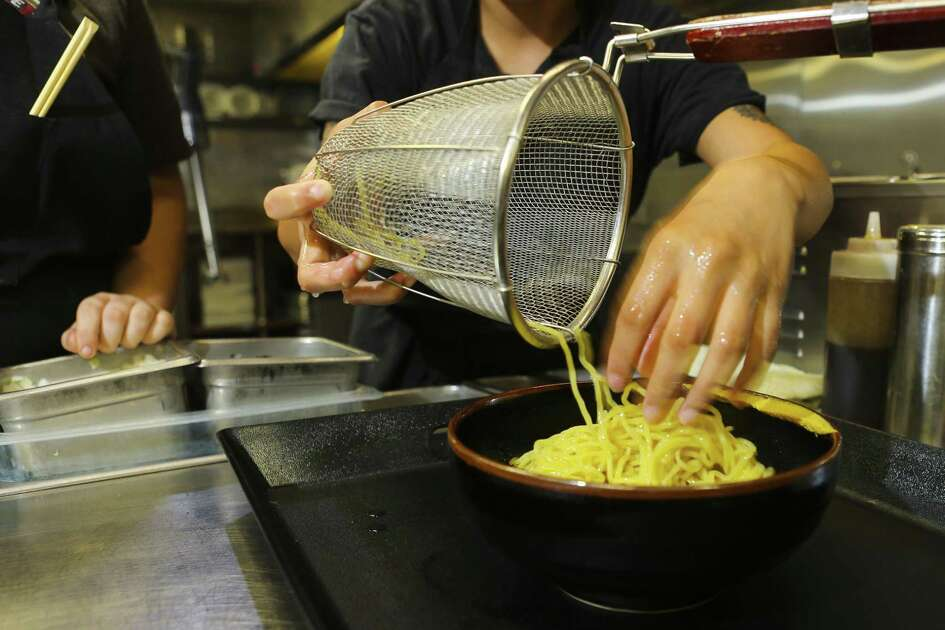 Line cook Jocelyn Noria prepares ramen at Ramen Tatsu-ya in Montrose, Thursday, July 12, 2018. Fresh ramen manufacturer Sun Noodle is considering  building a production facility in the Houston area. ( Mark Mulligan / Houston Chronicle )