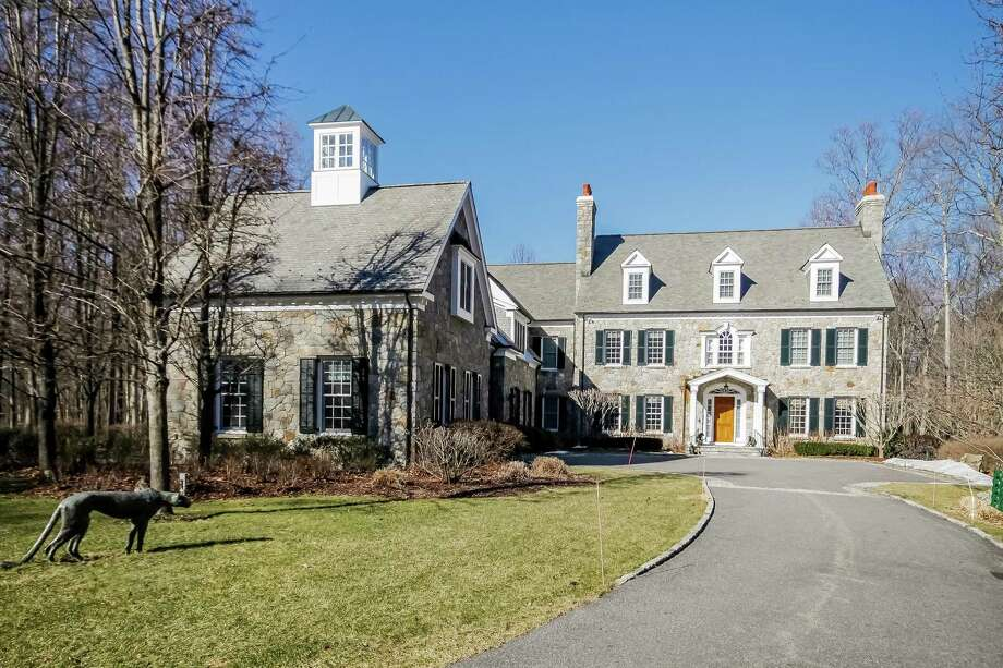The stone Georgian colonial house at 57 Summersweet Lane sits on a 5.13-acre level property on a cul-de-sac in a gated community. Photo: PlanOmatic / © 2017 PlanOmatic