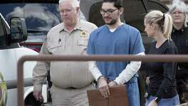 Marq Vincent Perez, who is accused of intentionally setting a fire that destroyed a mosque in Victoria, is escorted from the federal courthouse in Victoria after a Jan. 11 pretrial hearing. After hearing five days of trial testimony, the 12 jurors began deliberating early Monday afternoon.