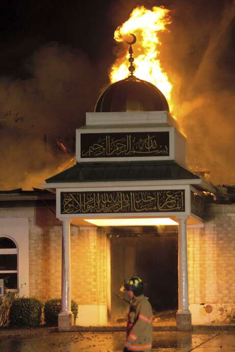 A firefighter walks in front of the Islamic Center of Victoria on Saturday, Jan. 28, 2017, in Victoria. Photo: File Photo /Victoria Advocate / victoriaadvocate.com