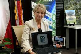 Houston Northwest Chamber of Commerce President Barbara Thomason shows off the new app that the chamber is having developed for the community at her office on May 29, 2018. (Jerry Baker/For the Chronicle)