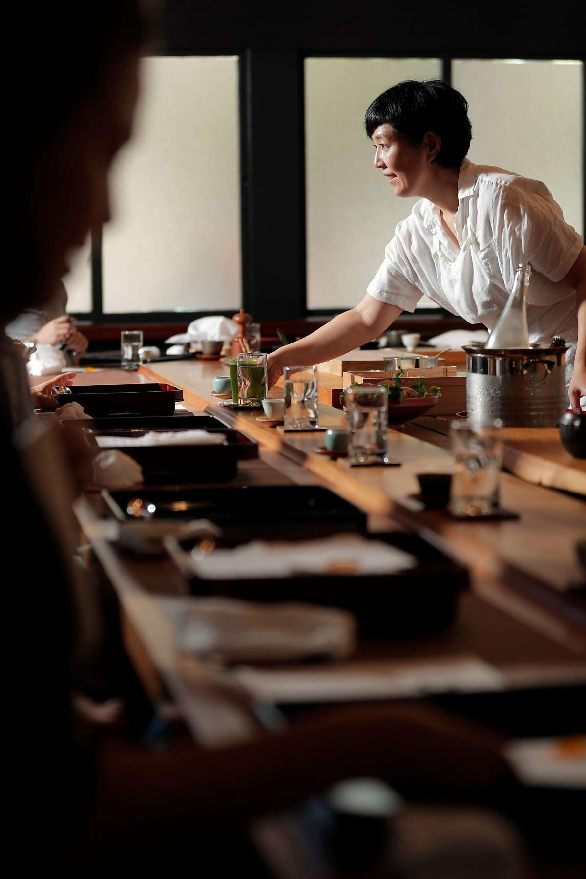 Junko Schwesig serves a dish to a guest during Oyatsuya, is a Sunday-afternoon pop-up by Schwesig, hosted at a sushi bar in San Francisco , Calif., on Sunday, July 15, 2018. Schwesig serves a multi-course tasting menu of Japanese sweets along with super-premium Japanese teas, including gorgeous little bites that are all about the peak of the season.
