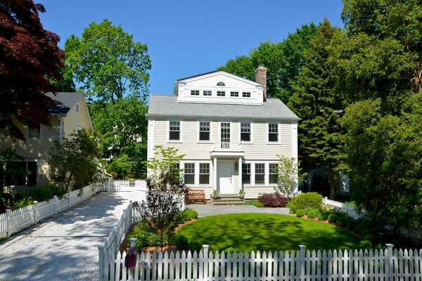 The Energy Star-rated colonial house at 19 Lakeside Avenue is across from Tilley Pond Park in a neighborhood that is walking distance to the train station and shops.