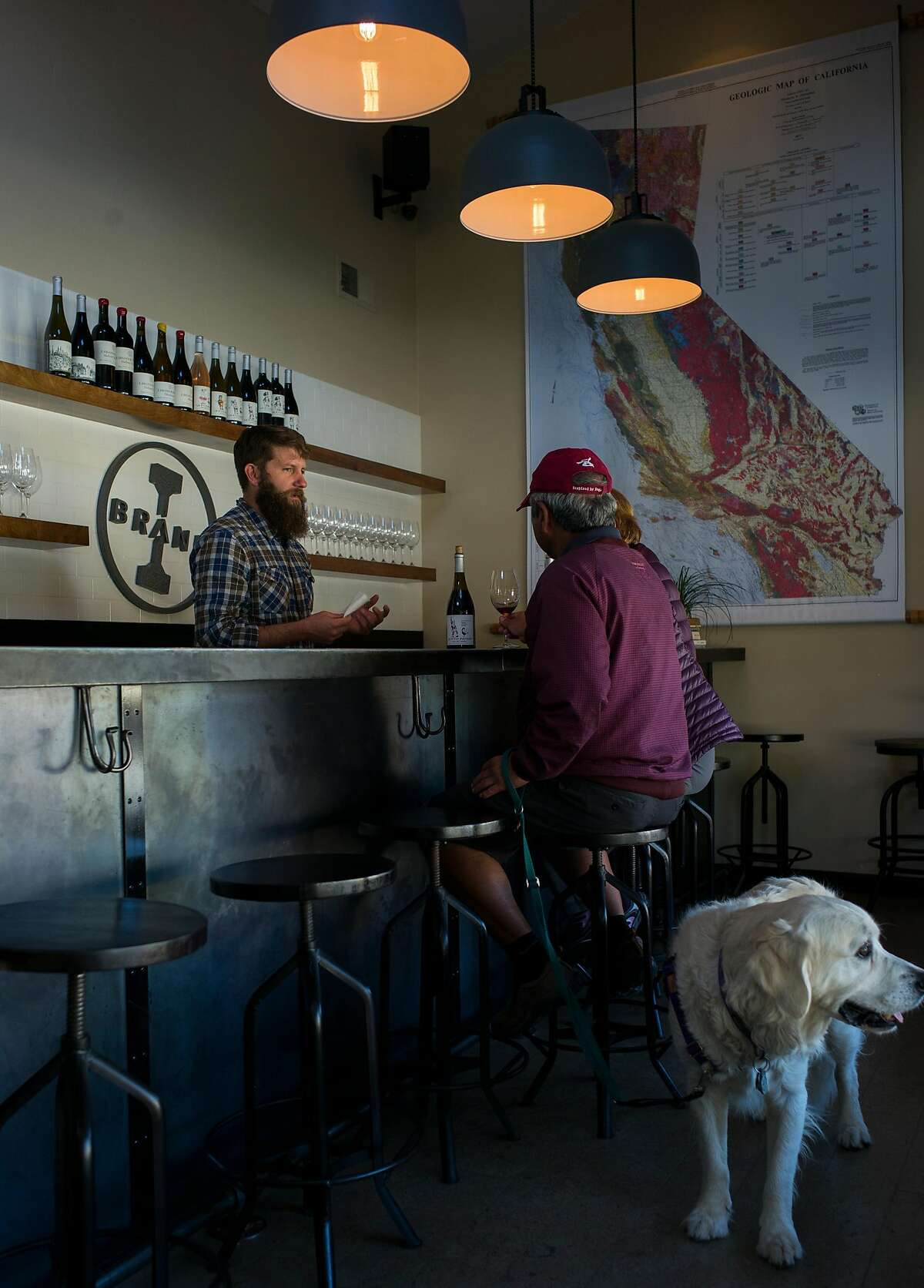 Winemaker Ian Brand (left) talks with customers at the I. Brand and Family tasting room in Carmel Valley, Calif.