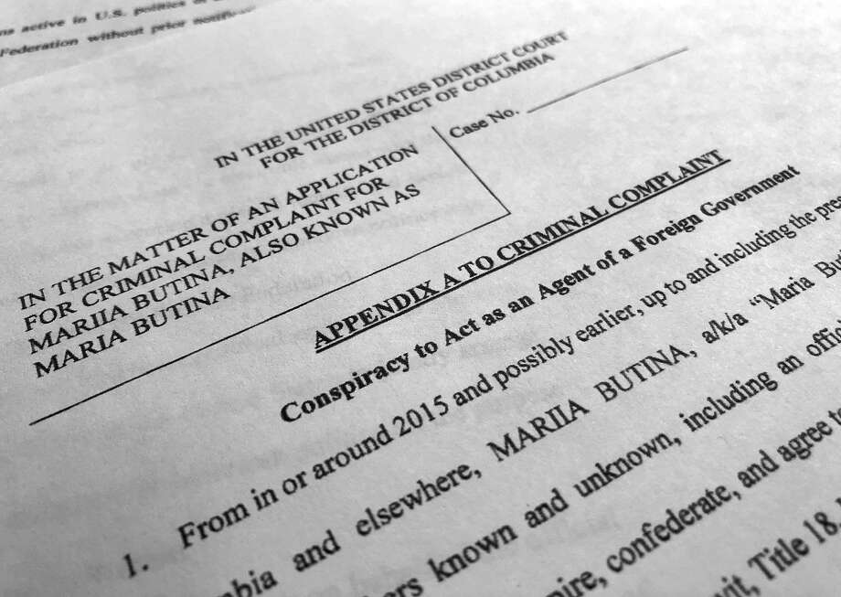 Court papers unsealed Monday, July 16, 2018, photographed in Washington, shows part of the criminal complaint against Maria Butina. She was arrested July 15, on a charge of conspiracy to act as an unregistered agent of the Russian government. (AP Photo/Jon Elswick Photo: Jon Elswick, Associated Press