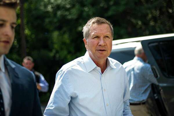 Republican Ohio Governor John Kasich walks into an Elks Club to speak to voters in Salem, New Hampshire on Wednesday, August 19, 2015.