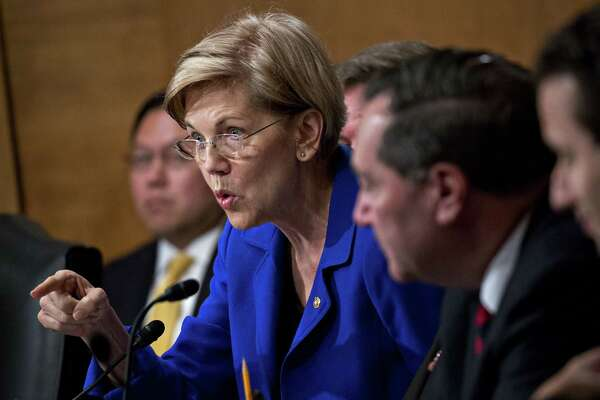 Sen. Elizabeth Warren, D-Mass., questions Richard Smith, former chairman and chief executive officer of Equifax., not pictured, during a Senate Banking Committee hearing in Washington on Oct. 4, 2017.