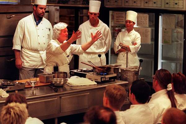 Chef/author Madeleine Kamman explains a point about making sauces to a class of students at SCCC Tuesday.