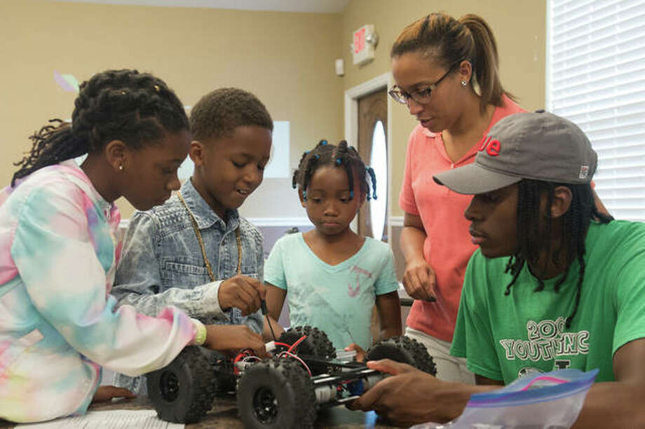 STEM Meets Humanities Robotics Program participants Kennedy Lacey, Jalen Mclemore and Aria Isom build a rover under the instruction of coordinator Candi Johnson and SIUE student Gaige Crowell. Photo:       For The Telegraph