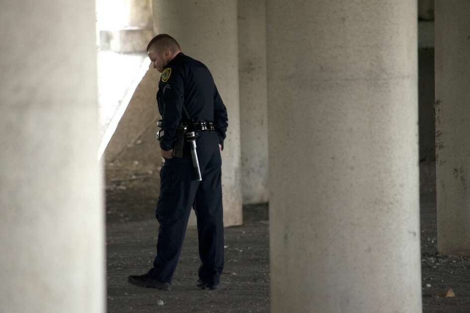 Houston police investigate the body of a male found underneath the Gulf Freeway overpass at Cullen Boulevard on Monday, July 16, 2018.