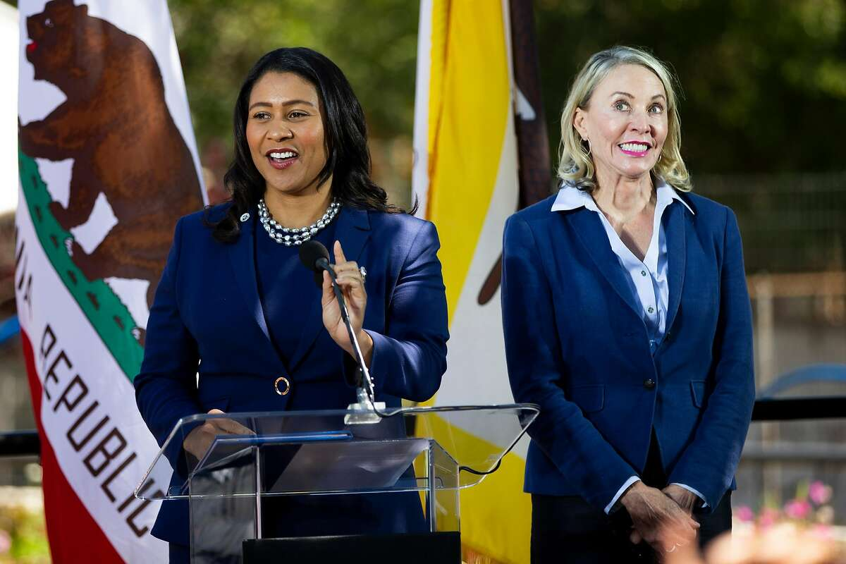 Newly appointed District 5 Supervisor Vallie Brown, right, reacts as she was being introduced by Mayor London Breed during Brown's swearing-in ceremony at the Hayes Valley Playground in San Francisco, Calif. on Monday, July 16, 2018.