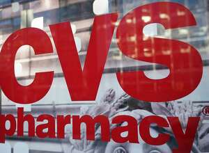 (FILES) In this file photo taken on December 3, 2017, the CVS logo is seen in front of one of its stores in Washington, DC. Shares of pharmacy retailers were hammered early on June 28, 2018, as Amazon entered the market and as Wall Street stocks retreated amid worries over trade tensions. Amazon announced it was acquiring online pharmacy PillPack for terms that were undisclosed, its biggest move yet into healthcare. Amazon shares rose 0.2 percent. But the move by Amazon pummeled pharmacy chains, with CVS Health diving 6.9 percent and Rite Aid plunging 12.6 percent.   / AFP PHOTO / MANDEL NGANMANDEL NGAN/AFP/Getty Images