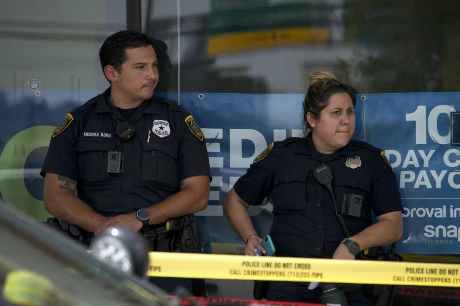 Houston police investigate a homicide inside a Mattress One store in the 4400 block of the North Freeway on Monday, July 16, 2018.